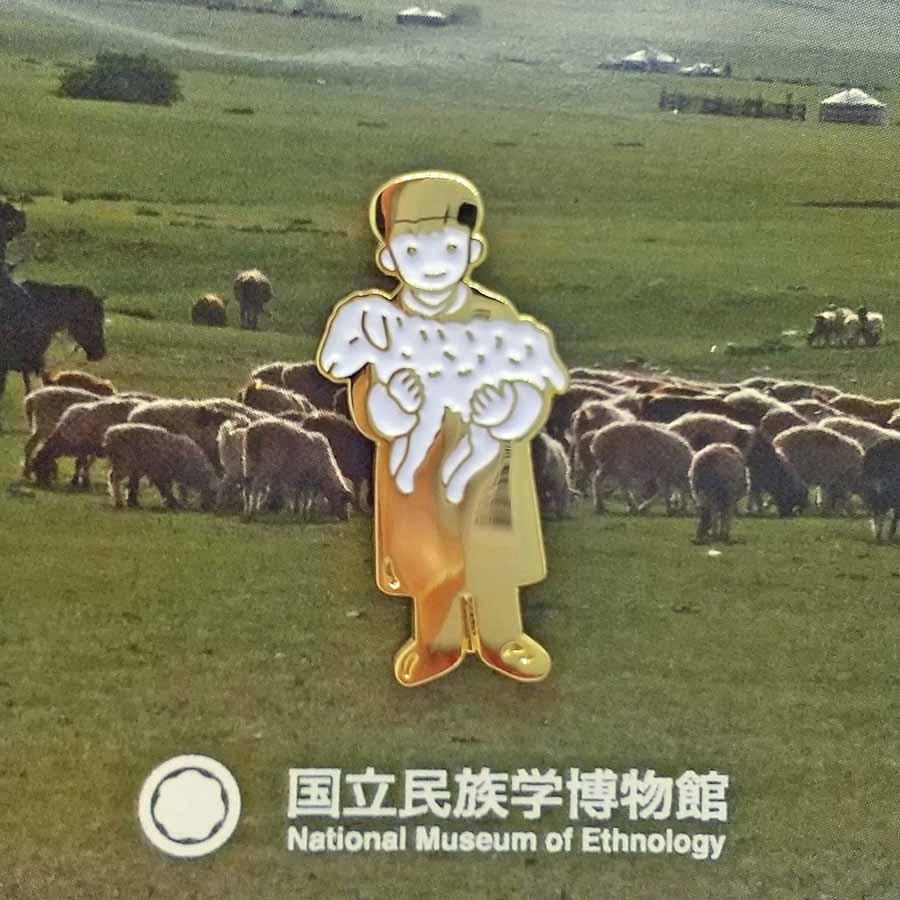 モンゴルの羊飼いの少年をピンバッジにデザイン